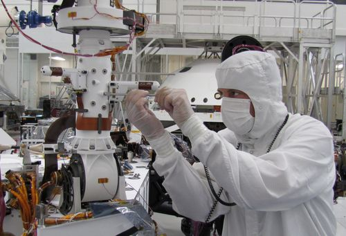 Sensors on two finger-like mini-booms extending horizontally from the mast of NASA