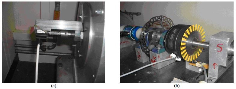 Photograph of the speed encoder for (a) flywheel and (b) dynamometer