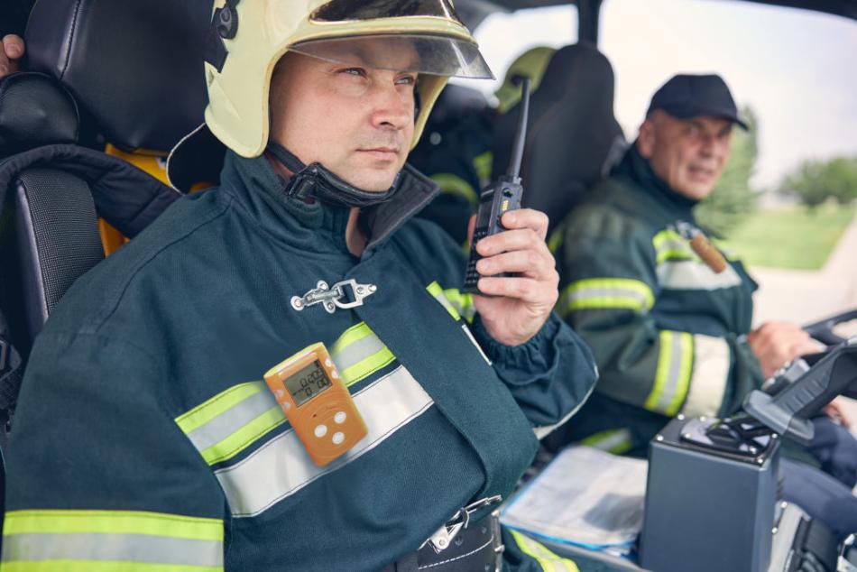Firefighter using SENKO's MGT-P portable multi gas detector.