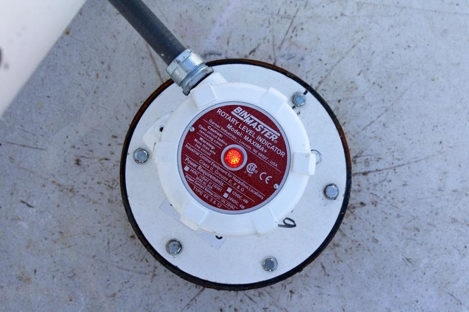 Sensors alert to full status to prevent overfilling silos.