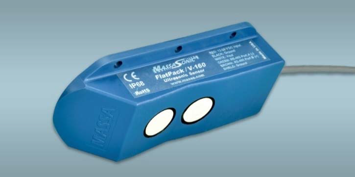 Photograph of a MassaSonic™ FlatPack™ ultrasonic sensor showing its shallow profile package and dual transducers, making it ideal for very close range detection of levels near the top of pipes and containers.