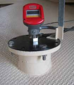 Scanner mounted on existing flange, using an adapter plate.